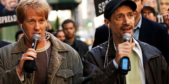 "In a April 26, 2006 file photo, radio shock jocks Greg ""Opie"" Hughes, left, and Anthony Cumia, right, leave CBS Radio studios on 57th Street with fans after finishing their first morning show, in New York.  (AP)"