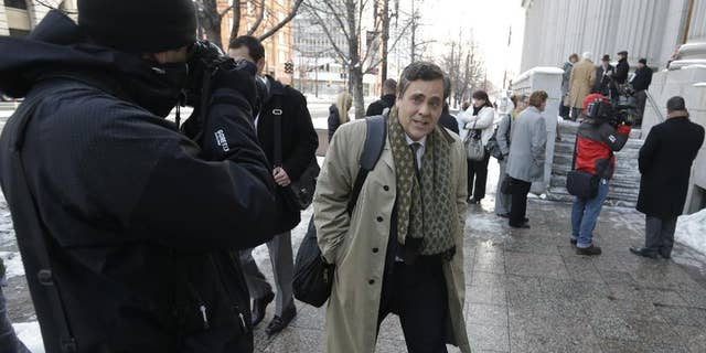 """FILE - In this Jan. 17, 2013, file photo, Jonathan Turley, attorney for Kody Brown and his four wives, the stars of the reality show """"Sister Wives,"""" leaves the Frank E. Moss United States Courthouse after a hearing on whether Utah can prohibit plural marriage, in Salt Lake City. A federal judge in Utah has issued a final ruling that strikes down parts of the state's anti-polygamy law, in a lawsuit filed by a family that appears on the TV show """"Sister Wives."""" The Brown family was overwhelmed and thankful for the ruling, said their attorney, Turley. (AP Photo/Rick Bowmer, File)"""