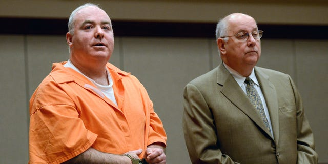 January 24: Michael Skakel, left, addresses the court with attorney his Hubert Santos in Middletown, Connecticut.  Skakel is seeking a reduction in his sentence of 20 years to life in prison for killing his neighbor Martha Moxley.