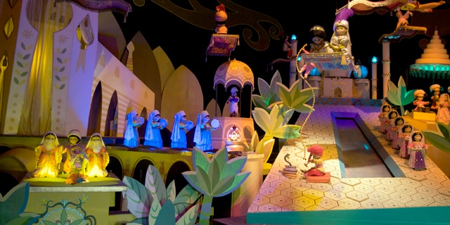 """The characters Aladdin, Jasmine and Abu from the film, """"Aladdin,"""" on the """"It's A Small World"""" ride, at Disneyland in Anaheim, Calif."""