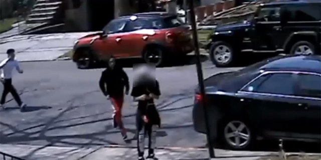 Police are investigating a mugging caught on video in which a 17-year-old was robbed of his  sneakers in Queens, N.Y., on April 28.