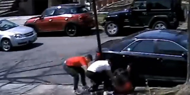 New York City police released surveillance footage showing a teen being robbed of his sneakers during a daylight mugging.
