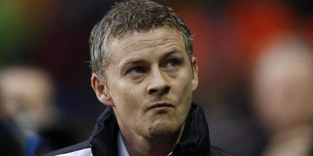 """FILE - In this Sunday, March 2, 2014 file photo, Cardiff City's manager Ole Gunnar Solskjaer looks on from the dugout before the start of their English Premier League soccer match against Tottenham Hotspur at White Hart Lane, London. Ole Gunnar Solskjaer has left his position as Cardiff manager, ending the former Manchester United striker's first coaching job in British football after nine months. Cardiff, which was relegated from the English Premier League under Solskjaer last season, says in a statement released Thursday that the Norwegian coach has """"stepped down ... with immediate effect following recent discussions."""" The Welsh club has lost three of its first seven games in the second-tier League Championship. Cardiff owner Vincent Tan says """"regrettably our recent results do not justify Ole's continued role as manager at Cardiff."""" (AP Photo/Sang Tan, file)"""