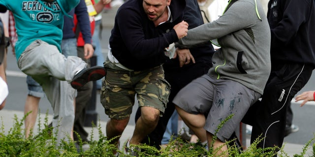 June 12, 2012: Fans clash prior to the Euro 2012 soccer championship Group A match between Poland and Russia in Warsaw, Poland.