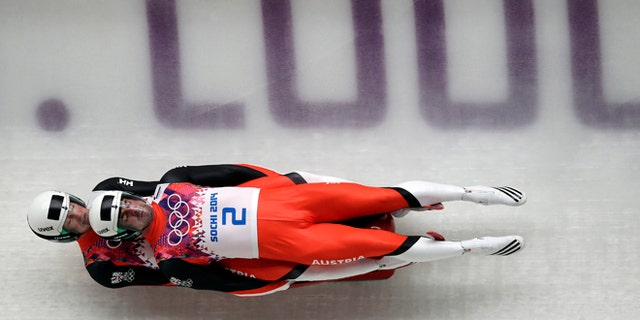 Feb. 12, 2014: The doubles team of Andreas Linger and Wolfgang Linger of Austria speed down the track in their final run during the men's doubles luge at the 2014 Winter Olympics.