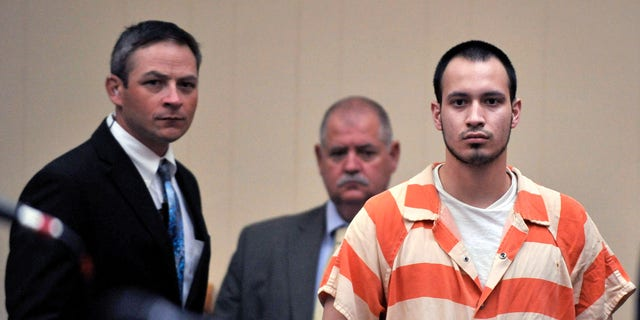 Aug. 30, 2012: In this file photo, Pvt. Isaac Aguigui walks into the courtroom during a preliminary hearing at Long County Superior Court in Ludowici, Ga.
