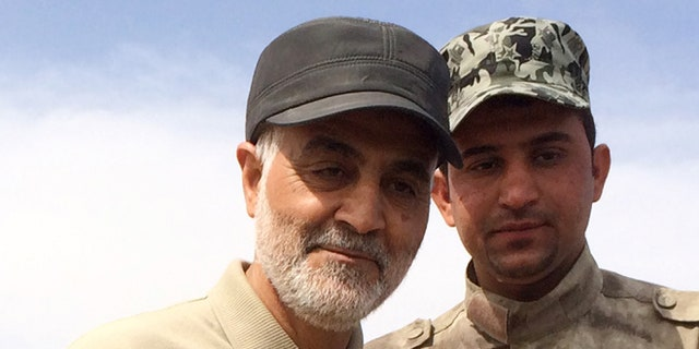 March 8, 2015: Gen. Qassem Soleimani, left, stands at the frontline during offensive operations against Islamic State militants in the town of Tal Ksaiba, Iraq.
