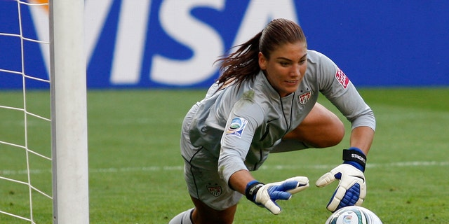 July 10, 2011:United States goalkeeper Hope Solo catches a ball during the quarterfinal match against Brazil at the Women's Soccer World Cup in Dresden, Germany. Solo received a public warning Monday, July 9, 2012, from the U.S. Anti-Doping Agency.