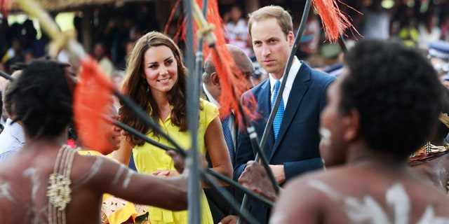 Sept. 17, 2012: Britain's William and his wife Kate, top center, the Duke and Duchess of Cambridge, watch a traditional dance at the Cultural Village in Honiara, Solomon Islands.