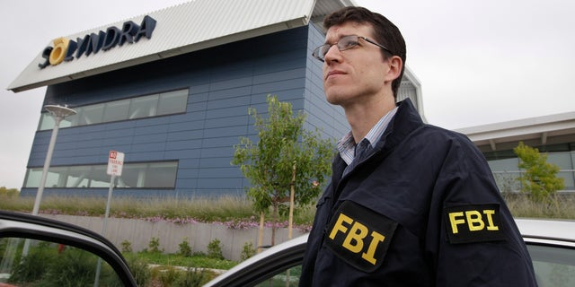 Sept. 8, 2011: FBI agents stand guard outside of Solyndra headquarters in Fremont, Calif.