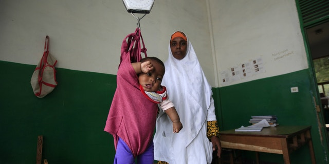 An internally displaced child is weighed at Banadir Hospital in Mogadishu, Somalia.