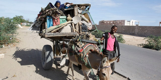 May. 7, 2014: A Somali refugee girl on a donkey fleeing the Somali capital due to hunger, to a refugee camp, in Mogadishu, Somalia.