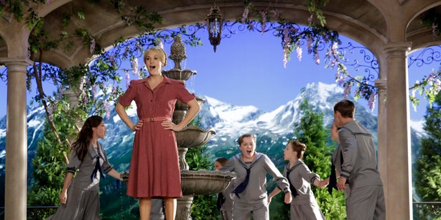"""This image released by NBC shows Carrie Underwood, foreground, as Maria, during preparations for """"The Sound of Music Live!"""", in Bethpage, N.Y. The live production aired on Dec. 5."""