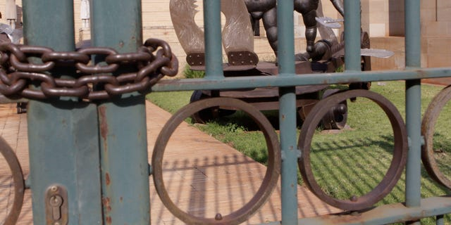 """Oct. 11, 2011: A metal sculpture titled: """"Tightroping"""" by sculptor David Brown is seen locked behind bars at the Johannesburg Art Gallery."""