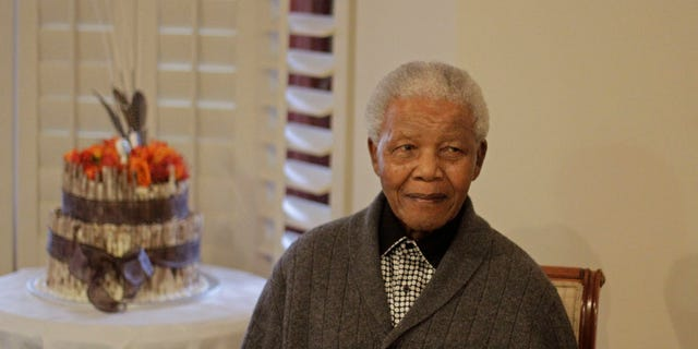 """July 18, 2012: File photo, former South African President Nelson Mandela as he celebrates his birthday with family in Qunu, South Africa. South African President Jacob Zuma says that former President Nelson Mandela has been admitted to hospital in Pretoria to undergo tests. Zuma issued a statement Saturday, Dec. 8, 2012 saying that Mandela is """"doing well and there is no cause for alarm."""""""