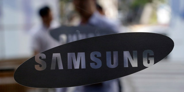 File photo - Aug. 31, 2012: People walk by the entrance to the Samsung Electronics Co. showroom at its headquarters in Seoul, South Korea. (AP)