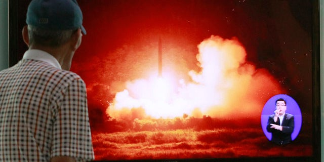 July 13, 2014: A man watches a TV news program showing a file picture of a missile launch conducted by North Korea, at Seoul Railway Station in Seoul, South Korea. (AP Photo/Ahn Young-joon)