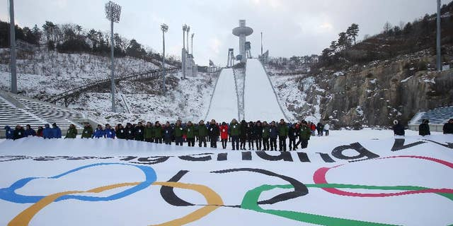Participants attend an event marking the three-year countdown to the start of the 2018 Winter Olympics in Pyeongchang, South Korea, Feb. 9, 2015.