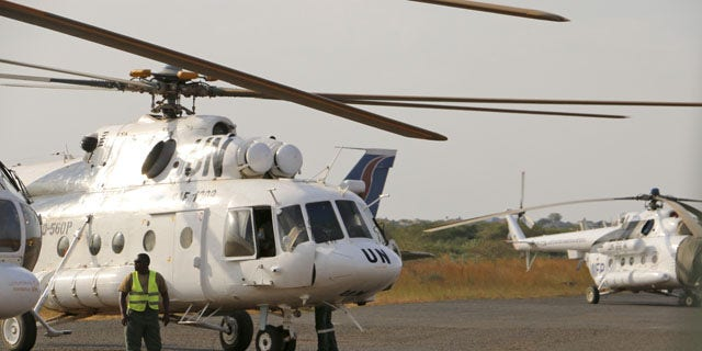 Sunday, December 22, 2013: In this photo released by the United Nations Mission in South Sudan (UNMISS), a U.N. helicopter transporting wounded civilians from Bor, the capital of Jonglei state and said to be the scene of fierce clashes between government troops and rebels, arrives at the airport in Juba, South Sudan. (AP/UNMISS)