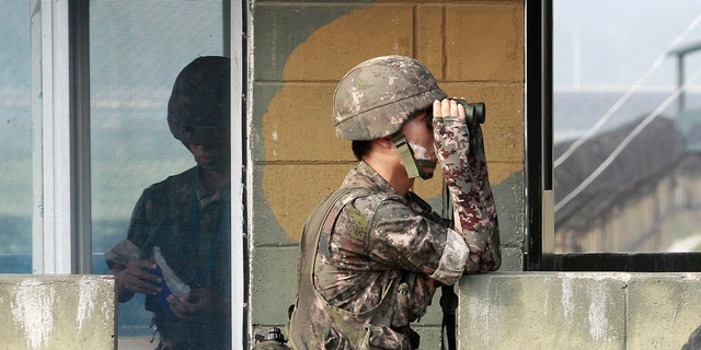 A South Korean army soldier looks through a pair of binoculars at a military check point at the Imjingak Pavilion near the border with North Korea.