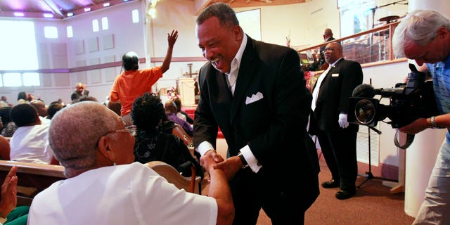 June 3: Reverend Fred Luter, pastor of the Franklin Ave. Baptist Church, greets congregation members during Sunday Services at the Church in New Orleans.