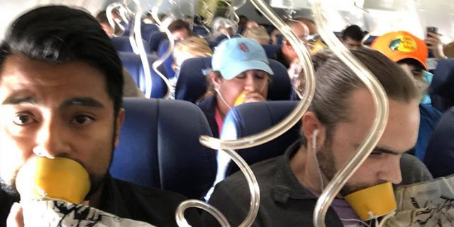 Passenger Marty Martinez captured the moment when oxygen masks were deployed on the flight.