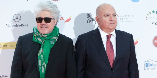 FILE - In this Monday Jan. 13, 2014 file photo, Spanish director Pedro Almodovar, left, and his brother the producer Agustin Almodovar poses for photographers during the photocall of the Jose Maria Forque Awards in Madrid, Spain. Agustin Almodovar said Monday, April 4, 2016, that he is blaming his lack of experience for a decision to set up an offshore company aimed at expanding their international film business in the 1990s. (AP Photo/Abraham Caro Marin, File)