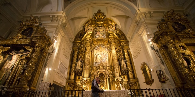 Two operators scan the altar with a Ground Penetration Radar at the Convent of the Barefoot Trinitarians in the historic Barrio de las Letras, or Literary Quarter in Madrid,  Spain, Monday, April 28, 2014.
