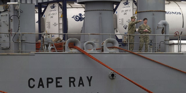 U.S. military personnel stand on the deck of American ship MV Cape Ray as it is docked at Naval Station in Rota, Spain, on Thursday Feb. 13, 2014. The American ship arrived on Thursday at the naval base of Rota on Spains southwestern coast used by the U.S. to resupply ahead of an unprecedented mission to collect and destroy mustard gas, raw materials for sarin nerve gas and tons of other highly toxic chemicals that form part of Syrias chemical weapons program. After leaving Spain, the Cape Rays next port of call is expected to be Gioia Tauro in southern Italy, where experts from the Organization for the Prohibition of Chemical Weapons say it will take on board 560 metric tons of chemicals that have been transported from the Syrian port of Latakia in two cargo ships from Denmark and Norway. (AP Photo/Miguel Angel Morenatti)
