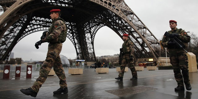Armed security patrols around the Eiffel Tower on January 9, 2015 in Paris, France.
