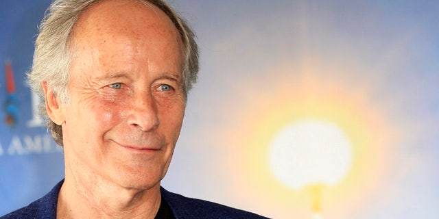 FILE - This is a Tuesday, Sept. 3, 2013 file photo of American novelist and short story writer, Richard Ford, as he poses during a photo call at the 39th American Film Festival, in Deauville, Normandy, western France. U.S. writer Richard Ford, author of the widely acclaimed novel âIndependence Day,â has won Spain's prestigious Asturias prize for literature in recognition of his contribution to American letters.  The award foundation Wednesday June 15, 2016  described Ford, 72, as the âgreat chronicler of the mosaic of interrelated stories that is North American society,â and the considered heir to U.S. literary giants, Ernest Hemingway and William Faulkner.  (AP Photo/Lionel Cironneau, File)