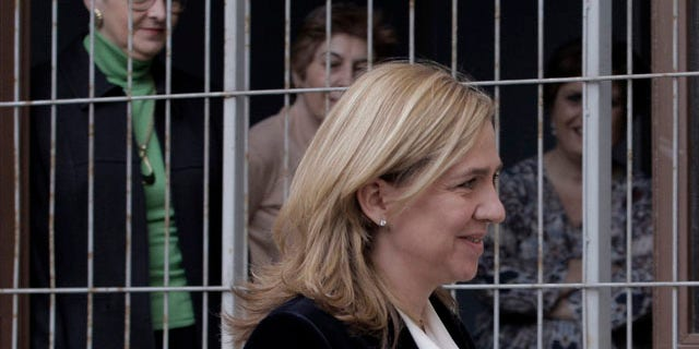 FILE - In this  Feb. 8, 2014 file photo, court workers look out of a window as Spain's Princess Cristina arrives at the courthouse in Palma de Mallorca, Spain. (AP Photo/Manu Mielniezuk, File)