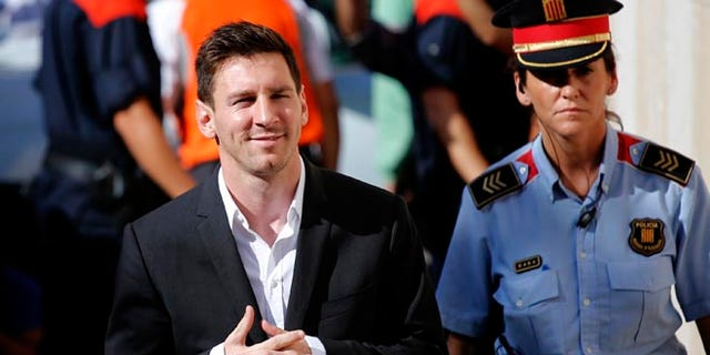FILE - In this Sept. 27, 2013 file photo, FC Barcelona soccer player Lionel Messi, left, arrives at a court to answer questions in a tax fraud case in Gava, near Barcelona, Spain. A Barcelona court on Friday July 6, 2016 sentenced Lionel Messi and his father Jorge Horacio Messi to suspended sentences of 21 months in prison each for tax fraud. The court found them guilty of three counts of tax fraud each. (AP Photo/Emilio Morenatti, File)