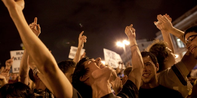 May 20: Demonstrators react as they reach midnight in Sol square in Madrid. Thousands of Spaniards defied a ban on a pre-election demonstration and have mounted a protest camp in the heart of the Spanish capital to express anger at political parties and the country's handling of the economic crisis.