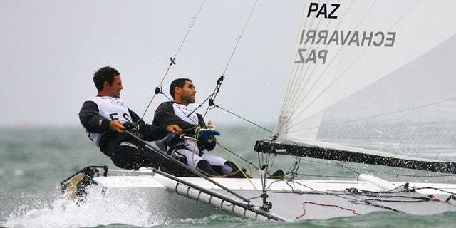 Anton Paz and Fernando Echavarri of Spain compete on their way to winning the Tornado class event held at the Qingdao Olympic Sailing Center during day 13 of the Beijing 2008 Olympic Games on August 21, 2008 in Qingdao, China.  (Photo by Clive Mason/Getty Images)