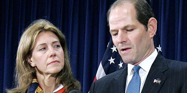 In this March 12, 2008, file photo, New York Gov. Eliot Spitzer announces his resignation amid a prostitution scandal as his wife Silda stands by at the governor's office in New York. Spitzer and wife Silda Wall Spitzer announced Tuesday, Dec. 24, 2013, that their marriage of more than two decades is over.