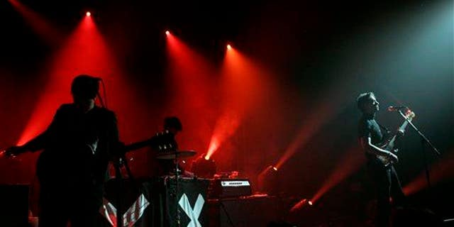 Romy Madley Croft, left, Oliver Sim, center, and Jamie Smith of the band The xx perform at the Bonnaroo Music and Arts Festival in Manchester, Tenn., June 10, 2010.