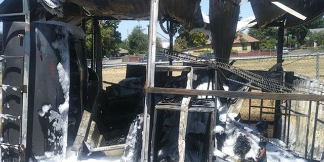 The trailer and attached grill, smoker, and miscellaneous equipment including refrigerators, slow cooker and signs went up in flames.