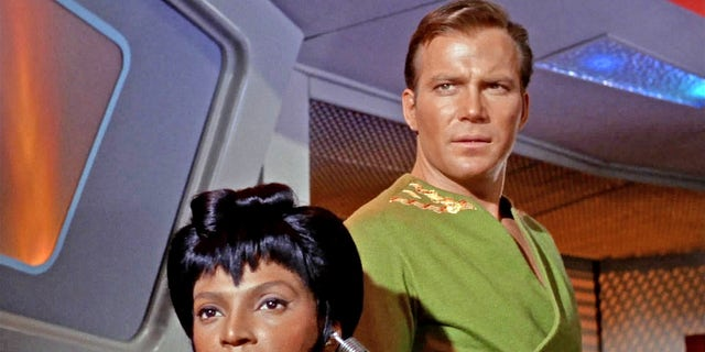 """Nyota Uhura, as played by Nichelle Nicols, and James T. Kirk, as played by William Shatner, starred in the original """"Star Trek"""" series. Despite becoming iconic years later, the series wasn't very popular when it first aired."""