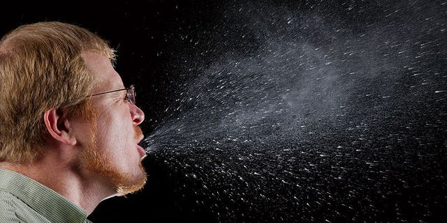 Droplets from a sneeze or cough can land on surfaces and potentially infect a nearby passenger sharing the enclosed space.