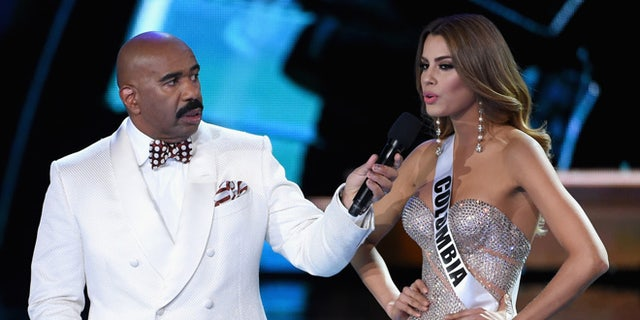 Steve Harvey listens as Miss Colombia answers a question during the 2015 Miss Universe Pageant on December 20.