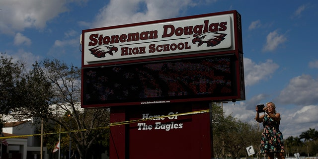 Two Marjory Stoneman Douglas students were arrested for knives, another student made online threats and a Broward County sheriff's deputy was suspended Tuesday.