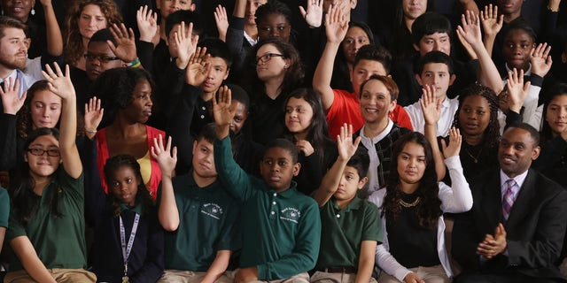 Students in Adelphi, Maryland, raise their hands when asked if they planned on going to college
