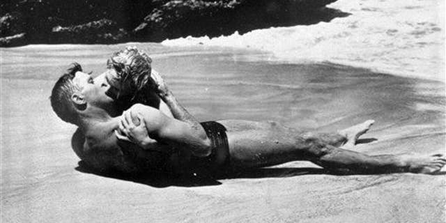 """Burt Lancaster kisses Deborah Kerr passionately in a beach scene in the 1953 film """"From Here To Eternity."""" The two shared one of cinema's most famous kisses .. and bacteria, most likely."""