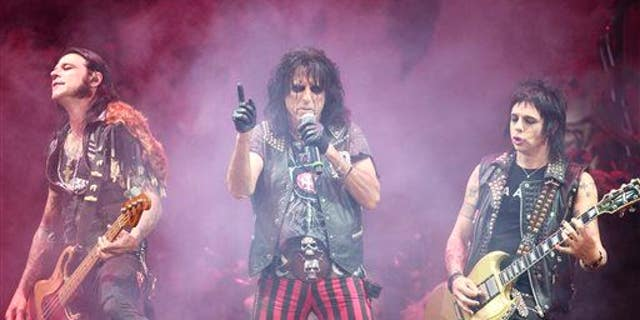 Alice Cooper opens for Motley Crue on July 2, 2014. The survey listed these bands as examples of heavy-metal groups: Guns N' Roses, Metallica, AC/DC, Def Leppard, Motley Crue, and Iron Maiden.