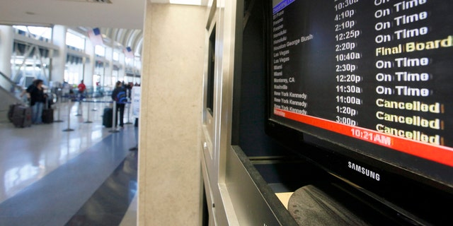 Oct 29, 2012 - File photo of display board with American Airlines canceled flights to New York.