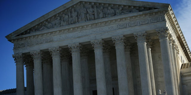 WASHINGTON, DC - JANUARY 09:  An exterior view of the U.S. Supreme Court January 9, 2015 in Washington, DC. The justices of the Supreme Court were scheduled to meet to determine whether the court will take up any of the five pending state-banned same-sex marriage cases in Ohio, Tennessee, Michigan, Kentucky and Louisiana.> on January 9, 2015 in Washington, DC.  (Photo by Alex Wong/Getty Images)