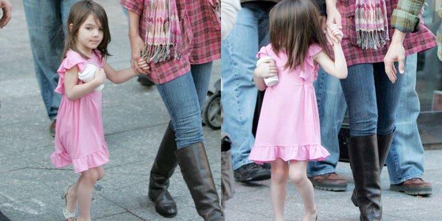 Suri Cruise is seen in high heels with her parents in October