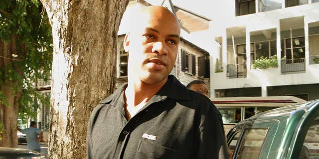 FILE - In this Aug. 26, 2003 file photo, Dino Bouterse, son of Suriname President Desi Bouterse, arrives to a court hearing in Paramaribo, Suriname. Dino Bouterse received leniency Tuesday, March 10, 2015, from a judge who ordered him to serve over 16 years in prison, about half of the 30-to-life term the U.S. government sought after he admitted that he offered a home base in his South American country to the Lebanese militant group Hezbollah. (AP Photo/Edward Troon, File)