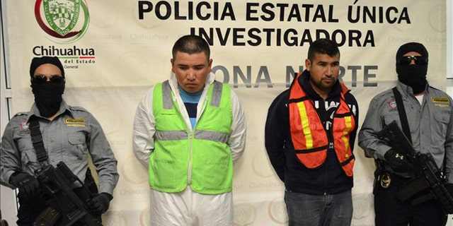 Mexican authorities present two suspects in the stabbing deaths of eight members of the same family. Jesus Daniel Mendoza Hernandez (left) and Edgar Uriel Lujan Guevara were arrested Tuesday in Ciudad Juarez, where the crime took place. EFE
